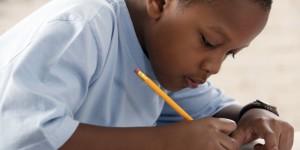 Boy writing at school